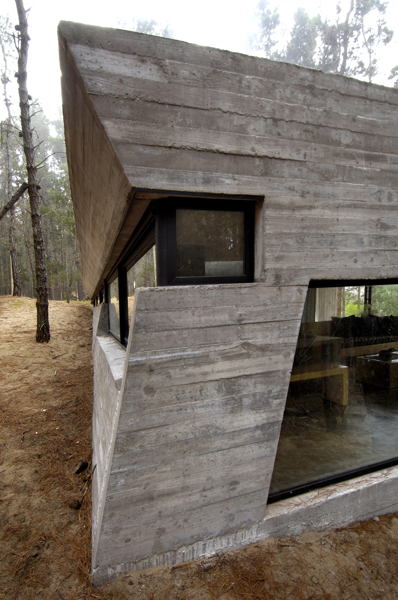 Galeria de casa de concreto bak arquitectos 9 for Casas alargadas