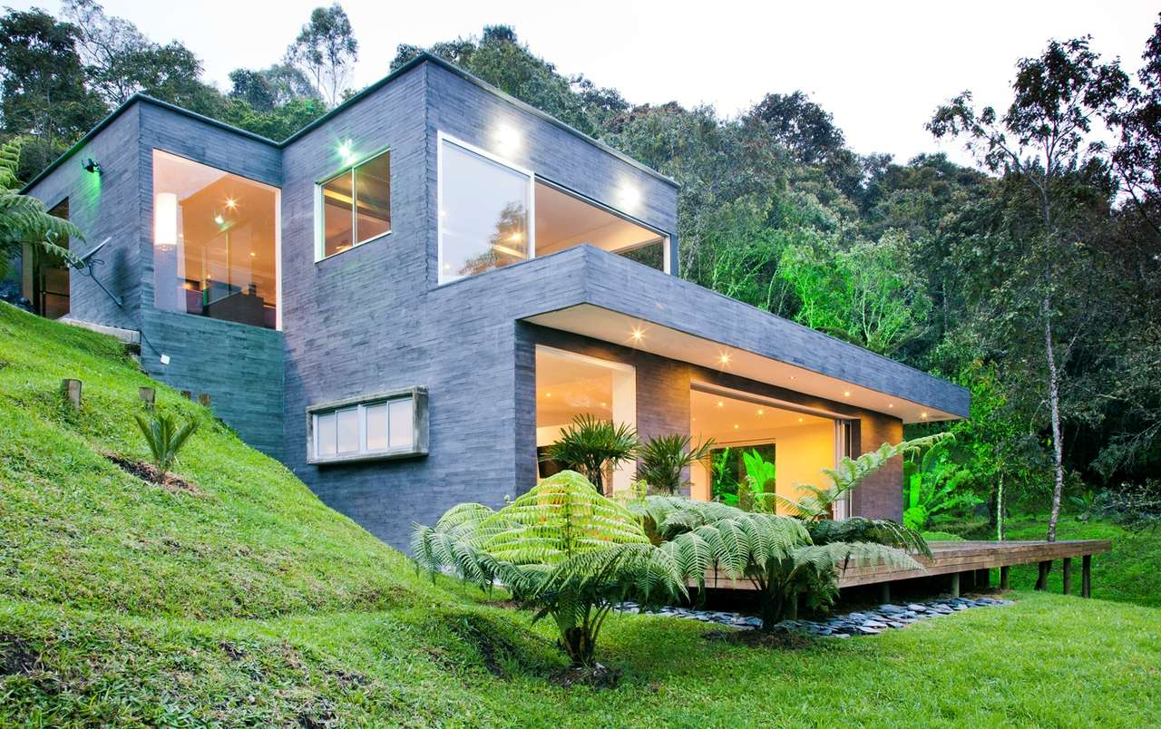 Casa lago no c u david ram rez arquitectos archdaily for Steep hillside house plans